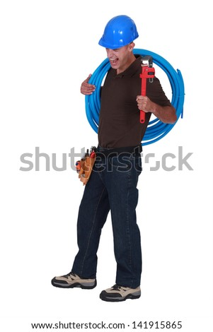 Plumber struggling - stock photo