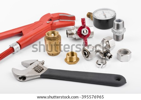 plumber tools and accessories on white background - stock photo
