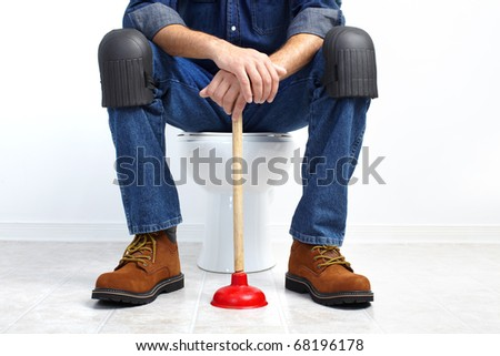 Plumber with a toilet plunger - stock photo