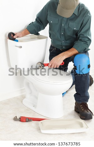 Plumber with a toilet plunger. The worker - stock photo