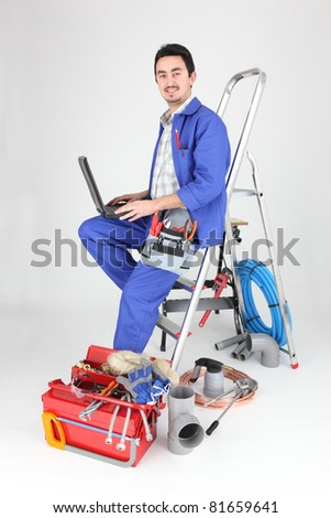 plumber with computer - stock photo