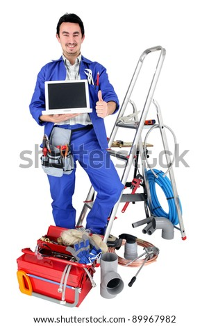 plumber with laptop - stock photo
