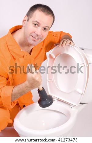 plumber with lavatorial bell and toilet bowl mechanic in overalls to clean a clogged toilet