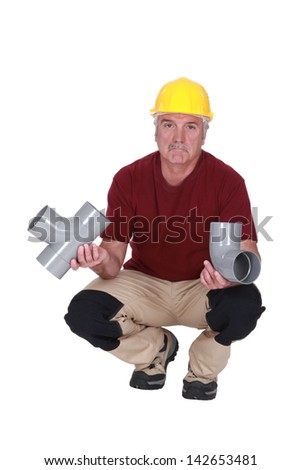 Plumber with plastic pipes - stock photo