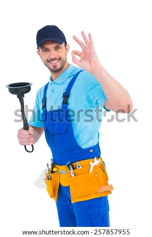 Plumber with plunger gesturing okay on white background - stock photo