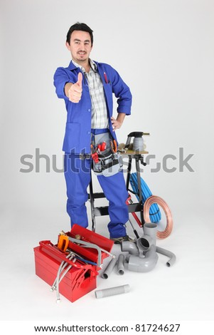 Plumber with thumbs up - stock photo