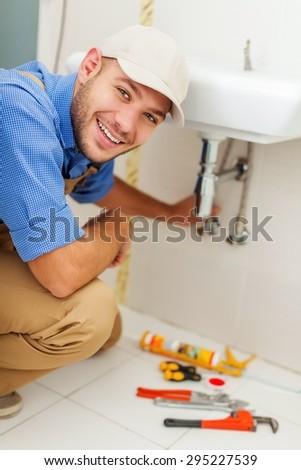 Plumber, worker, fix. - stock photo