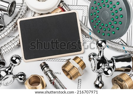 plumbing and blackboard for the text on the drawing - stock photo