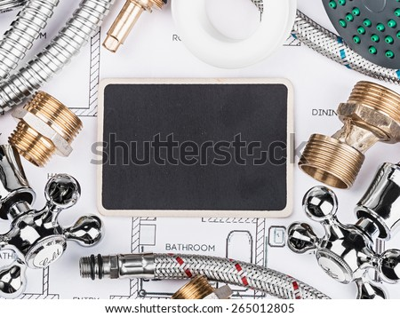 plumbing and blackboard for the text on the drawing. Empty space can be used for text - stock photo