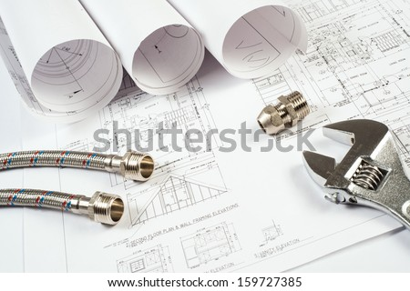 plumbing and drawings are on the desktop, workspace engineer - stock photo