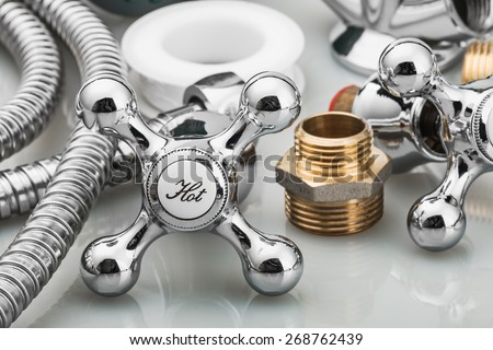 plumbing and tools in a light background. focus on the word hot - stock photo