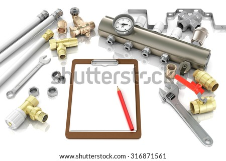 plumbing and tools with a notebook to write text - stock photo