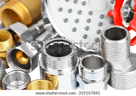 Plumbing fitting, tap and showerhead, isolated on white background - stock photo