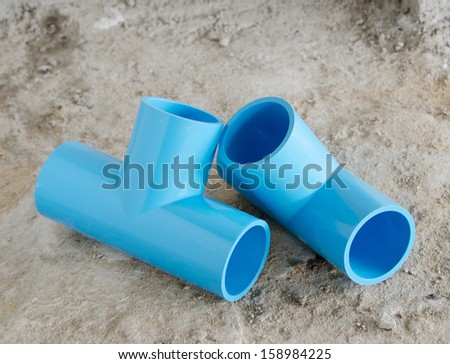 Plumbing fittings on the ground. - stock photo