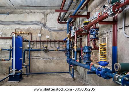 plumbing in the basement - stock photo