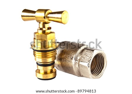 Plumbing Parts Of Brass And Stainless Steel On A White Background
