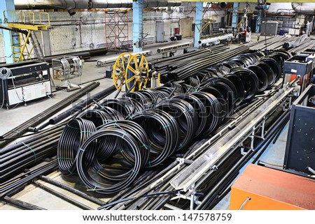 plumbing pipes, industry, manufacture of pipes - stock photo