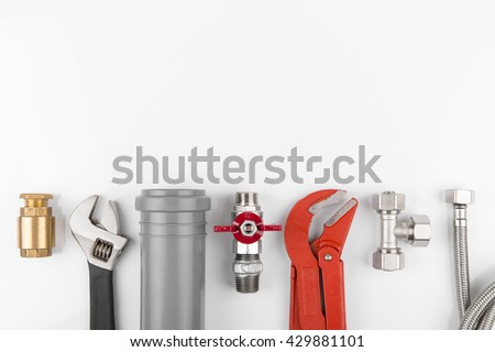 plumbing tools and equipment on white with copy space - stock photo
