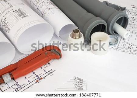 Plumbing tools on the construction drawings. Repair and construction of plumbing system - stock photo