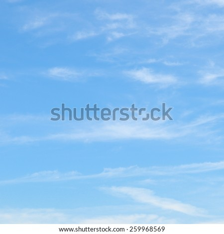 plumose clouds in the blue sky - stock photo