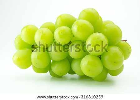 Plump green grape or muscat grape, isolated on natural white background. - stock photo