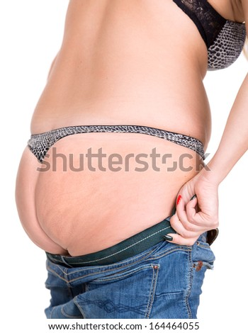 Plump woman trying to wear jeans