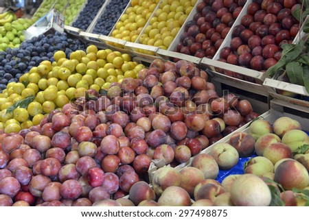 plums and peaches on display - stock photo