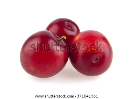 plums are isolated on a white background