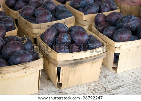 plums in produce boxes - stock photo