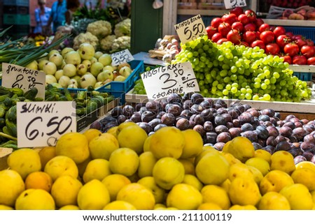 Plums on the market stand in Poland.  - stock photo
