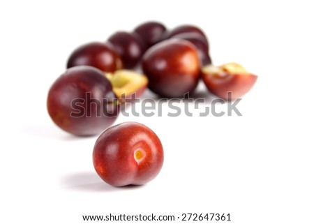 Plums on white bacground