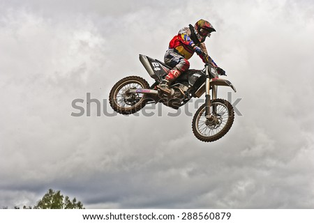 PLUNGE,LITHUANIA-MAY 11:Unidentified rider in action in Lithuanian Open Motocross Championship 2012 second roundon May 11,2012 in Plunge, Lithuania. - stock photo
