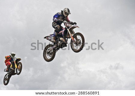 PLUNGE,LITHUANIA-MAY 11:Unidentified riders in action in Lithuanian Open Motocross Championship 2012 second roundon May 11,2012 in Plunge, Lithuania. - stock photo