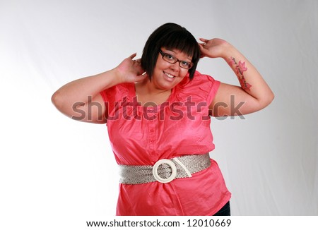 plus size black model with tattoo smiling
