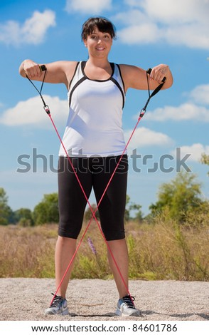 Plus Size Female Exercise Outdoor on Fitness Strap in water front