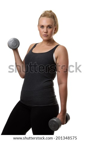 plus size model doing a fitness shoot lifting weights