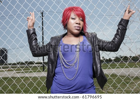 Plus size model in fashionable clothing and red hair