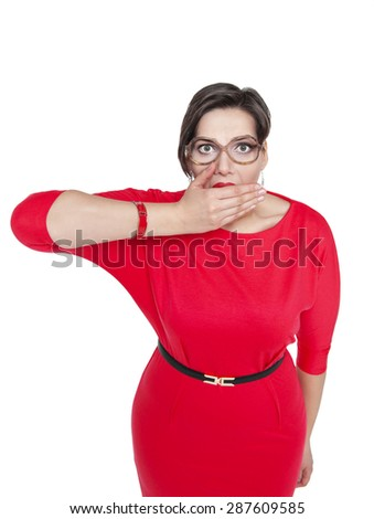 Plus size woman in glasses covering her mouth with hand isolated over white - stock photo