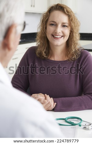 Plus Size Woman Meeting With Doctor In Surgery - stock photo