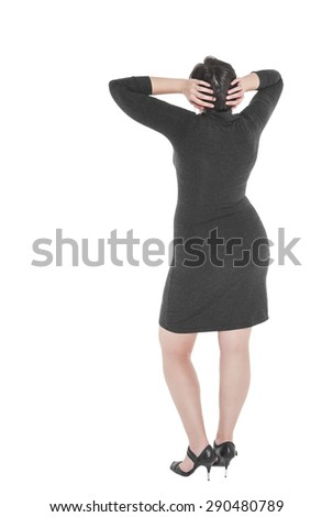 Plus size woman standing and looking on something isolated. Back pose, full length - stock photo