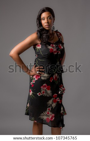 Plus Size Young African American Woman Standing Portrait on Grey Background - stock photo