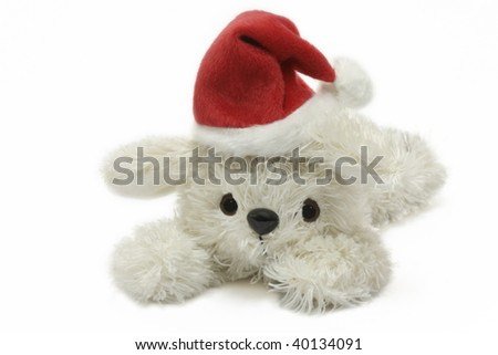 Plush bunny with santa hat over white background