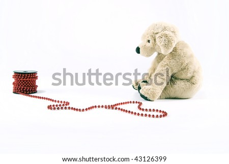 Plush puppy with red beads