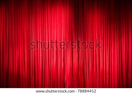 plush red velvet theater curtains. - stock photo