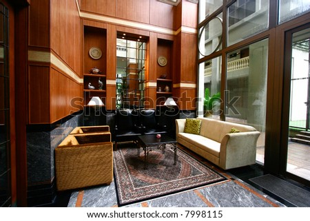 Plush seating area with sofas and leather seats in a lounging area. - stock photo
