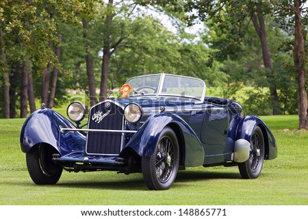 PLYMOUTH - JULY 28: A 1934 Alfa Romeo 8c 2300 Boat Tail Speedster owned by Roger Willbanks wins the Best of Show European Class at the 2013 Concours D'Elegance  July 28, 2013 Plymouth, Michigan. - stock photo