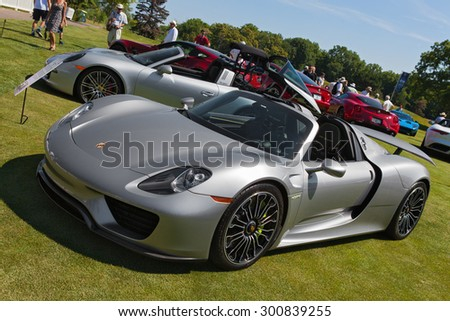 PLYMOUTH - JULY 26: A Porsche 918 Spyder on display July 26, 2015 at the Councors D'Elegance in Plymouth, Michigan. - stock photo