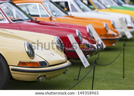 PLYMOUTH - JULY 28 : A row of Porsches on display at the Concours D'Elegance  July 28, 2013 in Plymouth, Michigan. - stock photo