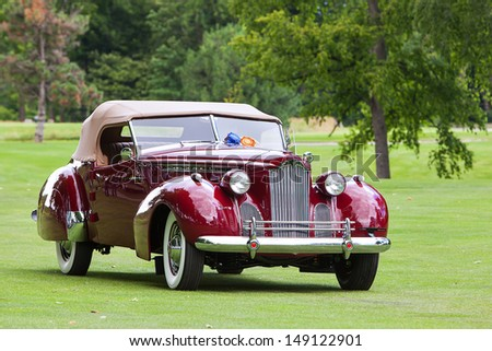 PLYMOUTH - JULY 28: A vintage Packard on display at the 2013 Concours D'Elegance  July 28, 2013 Plymouth, Michigan.