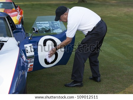 PLYMOUTH - JULY 29 : Prepping the cars for the Concours D'Elegance  July 29, 2012 in Plymouth, Michigan. - stock photo